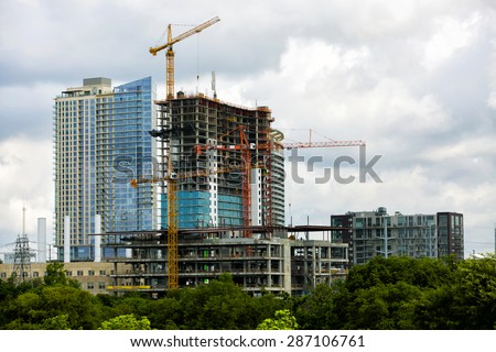 Construction of new modern building, downtown Austin, TX - stock photo