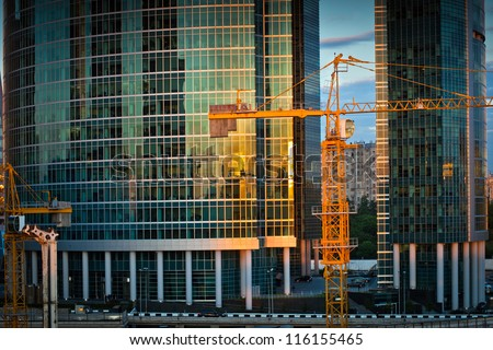 Construction of new Moscow business center. Crane near two skyscrapers. - stock photo
