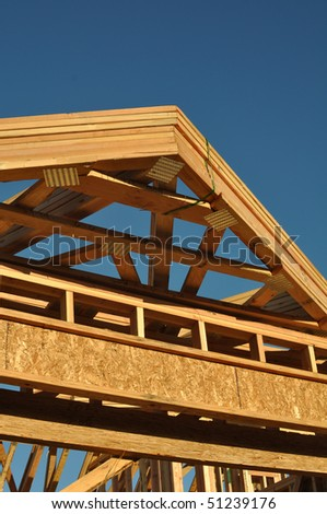 Construction of New Roof on Home with Blue Sky - stock photo