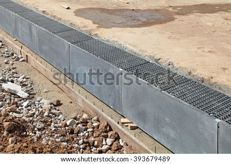 Construction of pavement, installation of storm drain - stock photo