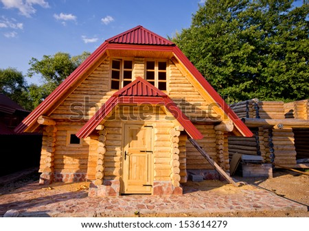 Construction of prefabricated wooden houses - stock photo