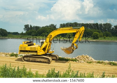 Construction of quay on a city beach - stock photo