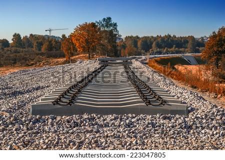 Construction of railway line using concrete sleepers - stock photo