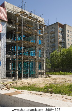 Construction of residential houses. City scenery - stock photo