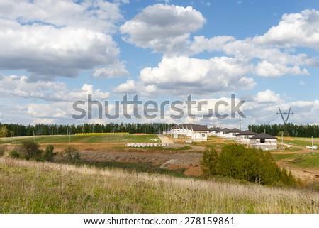 Construction of suburban housing. Sunny summer day - stock photo