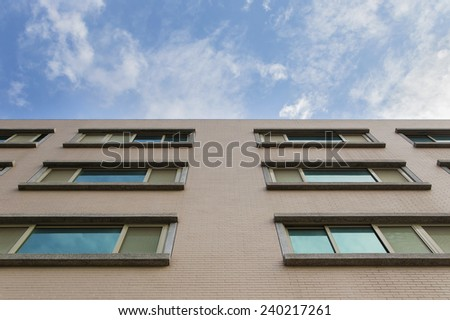 construction of the apartment on blue sky background - stock photo
