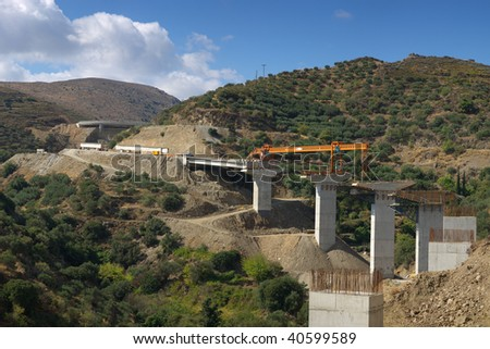 Construction of the bridge in mountains on island Crete - stock photo