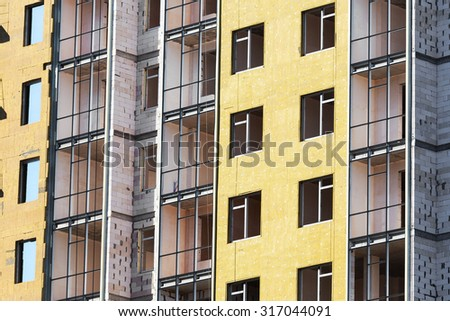 Construction of the building with external insulation - stock photo