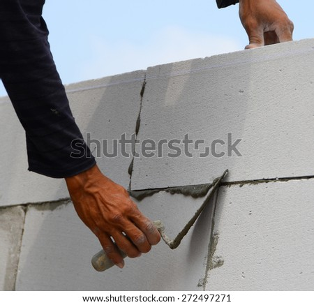 Construction of the wall of white brick. - stock photo