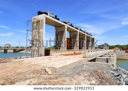 Construction of water gate with blue sky - stock photo