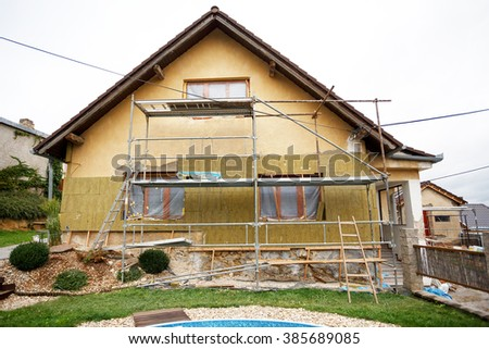Construction or repair of the rural house, fixing facade, insulation and using color - stock photo
