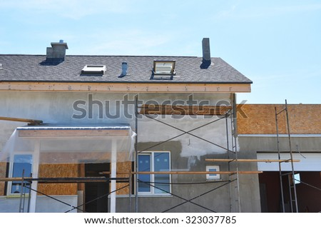 Construction or Repair of the Rural House with Skylights, Ventilation, Eaves, Windows, Garage, Doorway, Chimney, Roofing, Fixing Facade, Insulation, Plastering and Using Color.  - stock photo