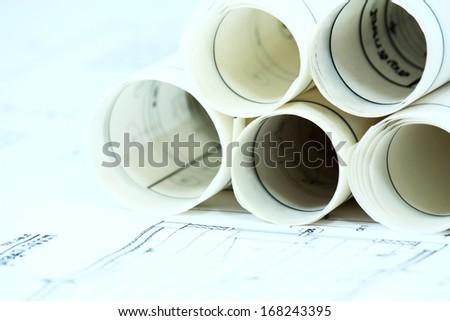 construction paperwork on  desk - stock photo