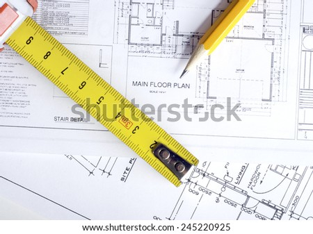 Construction planning drawings on the table and  yellow pencil with ruler - stock photo