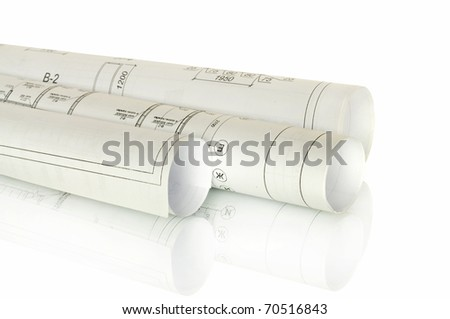 construction plans in rolls isolated on white and reflection - stock photo