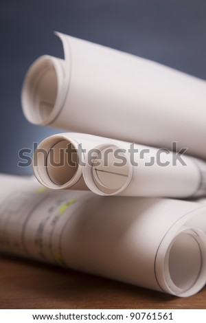 Construction plans with helmet and drawing tools on blueprints - stock photo