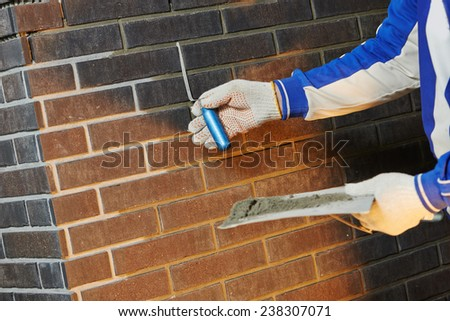 Construction Process of bricklaying Using the Brick Jointer Trowel - stock photo