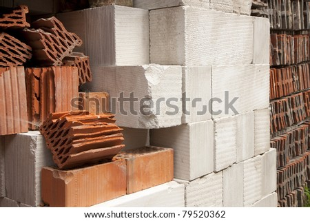 Construction red and white blocks in a pile