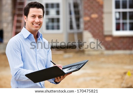 Construction: Resident Architect or Real Estate Agent. - stock photo
