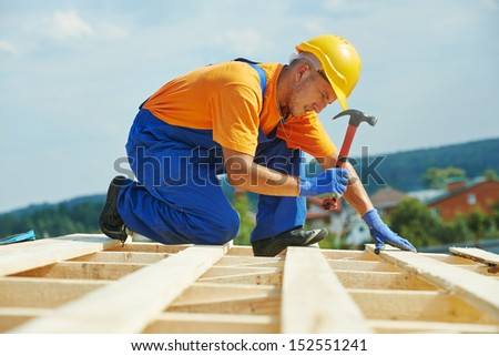 construction roofer carpenter worker nailing wood board with hammer on roof installation work & Roofing Construction Stock Images Royalty-Free Images u0026 Vectors ... memphite.com
