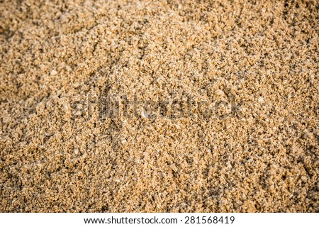 Construction sand pile and rocks - stock photo