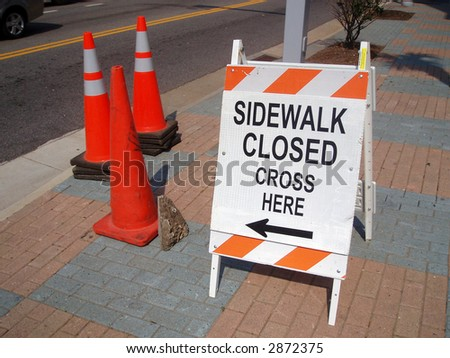 Construction sign and cones