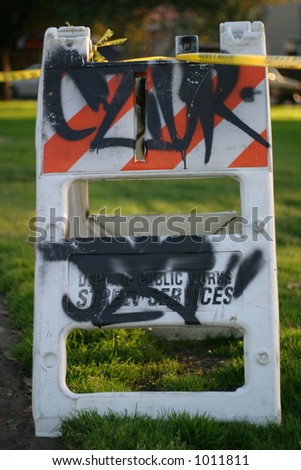 Construction sign with grafitti - stock photo