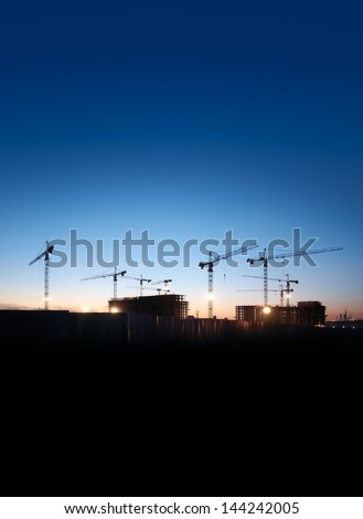 construction site against the evening sky - stock photo