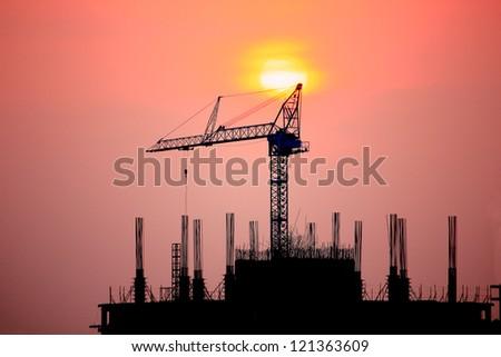 Construction site against the light at sunset period