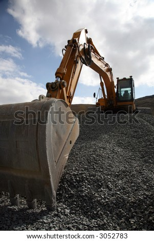 Construction Site and Heavy Machinery - stock photo