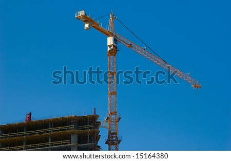 Construction site and the crane - stock photo