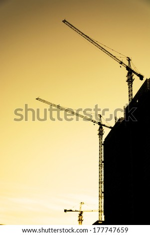 Construction site at dusk. - stock photo