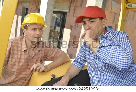 Construction site colleagues having a chat - stock photo