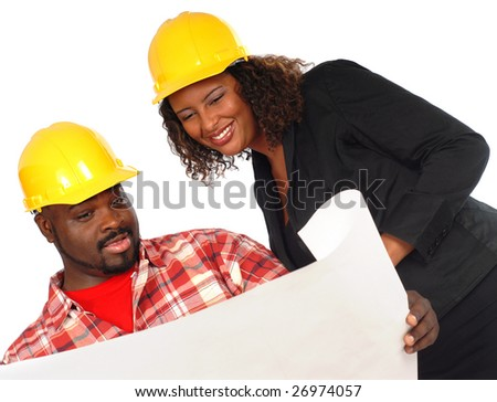 Construction site concept with workers analyzing blueprints - stock photo