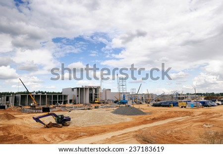 Construction Site, construction machinery, bulldozer, excavation, factory - stock photo