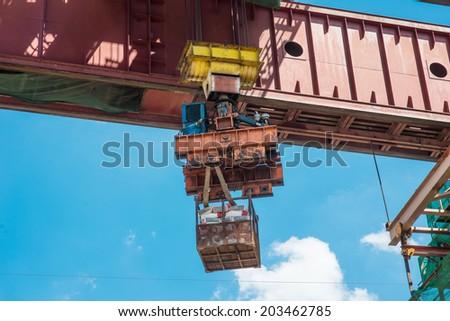 Construction site crane is lifting a concrete  - stock photo