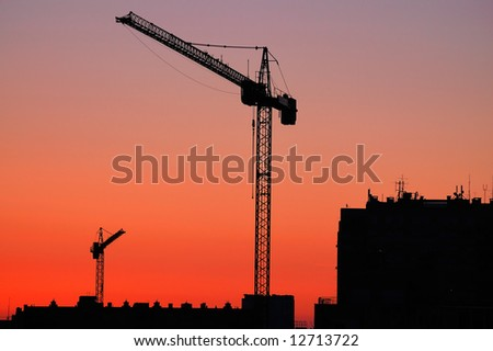 Construction site - cranes at dawn - stock photo