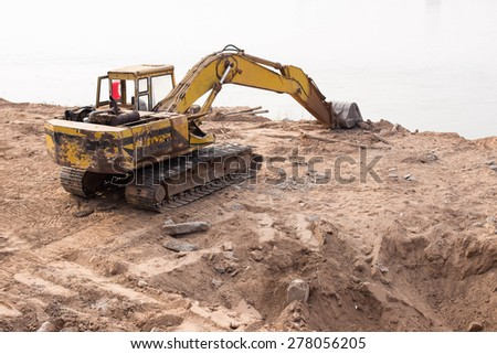 construction site digger, excavator industrial machinery - stock photo