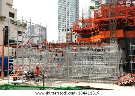 Construction site during scaffolding erection - stock photo