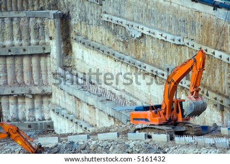 Construction site. Excavator in construction pit. - stock photo