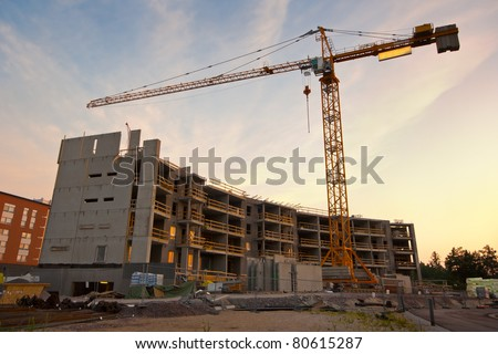 Construction site in morning dawn - stock photo