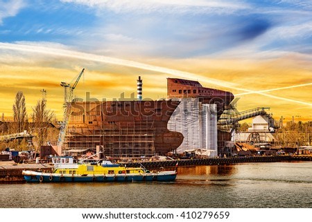 Construction site in the shipyard at sunrise. Gdansk Poland. - stock photo