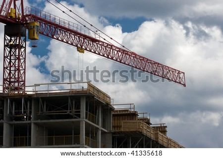Construction site including concrete structure and crane - stock photo