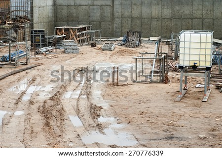 Construction site, muddy roads, rainy spring season - stock photo