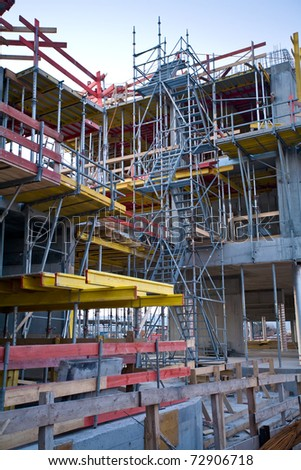 Construction site of a building with scaffold - stock photo