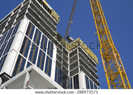 Construction site of a modern office building - stock photo