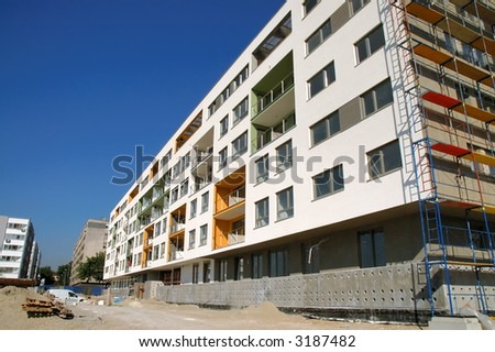 Construction site of almost finished modern building - stock photo