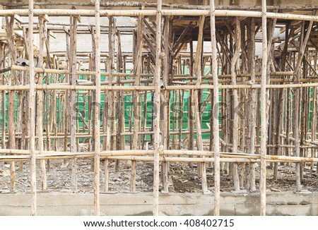 Construction site of concrete building with wooden frames. - stock photo