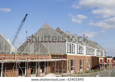 Construction site of local homes with rooftops. - stock photo