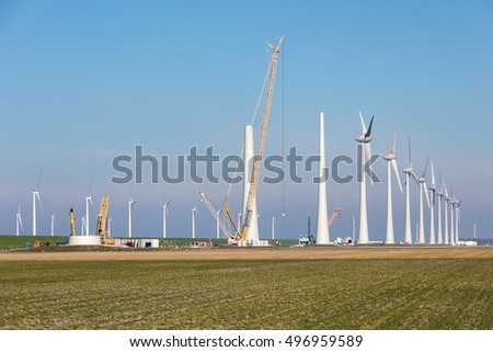 Construction site of new Dutch wind farm in agricultural landscape